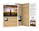 Woman lifting up her hands at sunset Brochure Template