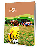 Young boy child in uniform watching organized youth soccer or football game from sidelines Presentation Folder