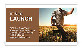 Young man with laptop in hand running on meadow with dandelions Business Card Template