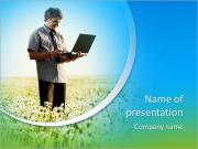Happy young man with laptop in hand standing on meadow with dandelions PowerPoint Templates