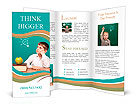 Cheerful little boy sitting at the table. School concept Brochure Templates