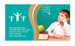 Cheerful little boy sitting at the table. School concept Business Card Templates