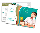 Cheerful little boy sitting at the table. School concept Postcard Templates