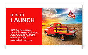 Red vintage pick up truck with American flag in wide open country side with dramatic sunset cloudsca Business Card Template
