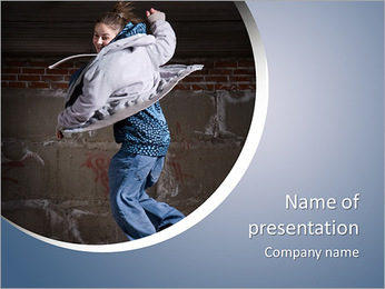 Hip hop girl dancing in modern style over urban grey brick wall PowerPoint Template