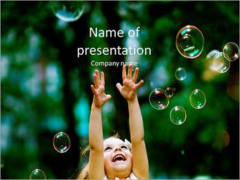 Girl enjoys soap bubbles PowerPoint Template