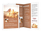 Gorgeous photography loving couple on the beach Brochure Templates
