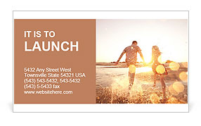 Gorgeous photography loving couple on the beach Business Card Template