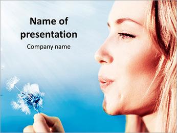 Beautiful girl blowing a dandelion PowerPoint Template