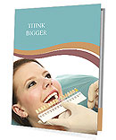 The dentist selects the shade of the teeth girl Presentation Folder