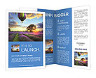 Multi-colored balloons on a background of a sunset Brochure Templates