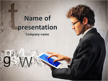 Young businessman working on a tablet PowerPoint Template