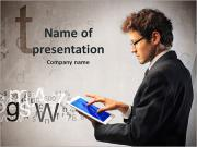Young businessman working on a tablet PowerPoint Templates