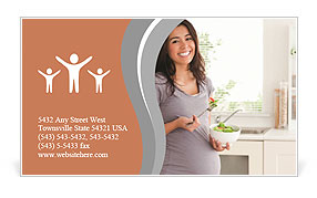 A young pregnant woman is standing with a smile in the kitchen Business Card Templates