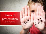 Stop Bullying Written on Boy's Palms Plantillas de Presentaciones PowerPoint