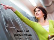 Teacher Points at Blackboard PowerPoint Templates