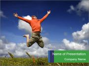 Man Jumping on Green Meadow PowerPoint Templates