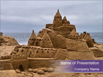 Huge Sand Castle on the Beach PowerPoint Template