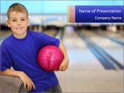 Small Boy Loves Playing Bowling PowerPoint Templates