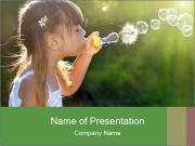 Little Girl Playing with Bubbles PowerPoint Templates