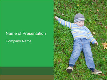 Small Boy Lying on Green Grass PowerPoint Template