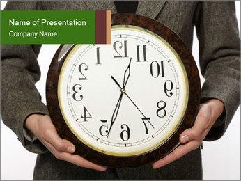 Man Holding Clock PowerPoint Template