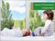 Small Girl Playing with Baby PowerPoint Templates