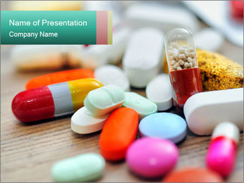 Various Pills Lying in the Table PowerPoint Template