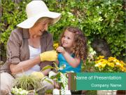 Granny with Small Girl Planting Flowers PowerPoint Templates