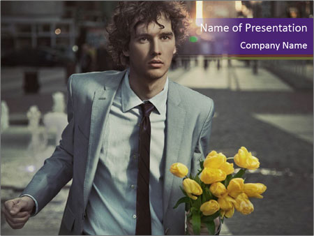 Attractive Guy with Yellow Tulips PowerPoint Templates