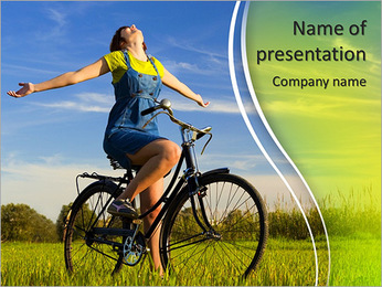 Happy girl over a bicycle and looking the view, in a green meadow PowerPoint Template