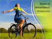 Happy girl over a bicycle and looking the view, in a green meadow PowerPoint Templates