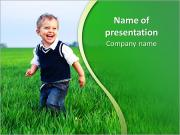 A cute little baby boy sit in the grass PowerPoint Templates