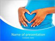 Pregnant woman builds heart on her baby bump PowerPoint Templates