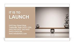 Balancing balls on wooden board Business Card Templates
