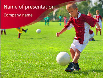 A boy playing football PowerPoint Template