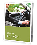 A man in a suit riding and driving Presentation Folder