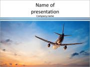Airplane flying above tropical sea at sunset PowerPoint Templates