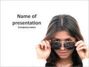 Very beautiful brunette looking through dark glasses PowerPoint Templates