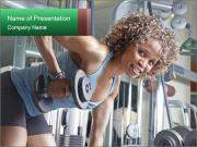 Woman working out in the gym PowerPoint Template