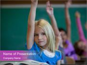 Girl raising hand in classroom PowerPoint Template