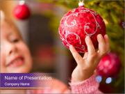 Girl helping decorating the Christmas tree PowerPoint Template