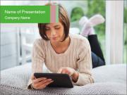 Woman using tablet pc PowerPoint Template
