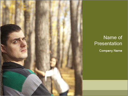 Couple standing in the park PowerPoint Templates