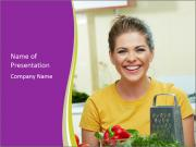 Happy woman in kitchen PowerPoint Templates