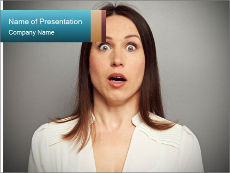 Frightened woman looking at camera over dark background PowerPoint Templates