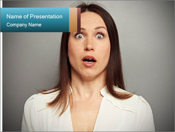 Frightened woman looking at camera over dark background PowerPoint Template - Slide 1