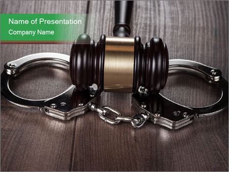 Handcuffs and judge gavel on brown wooden PowerPoint Templates