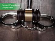 Handcuffs and judge gavel on brown wooden PowerPoint Template