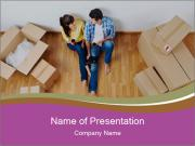Overhead view of couple moving in to new home PowerPoint Template